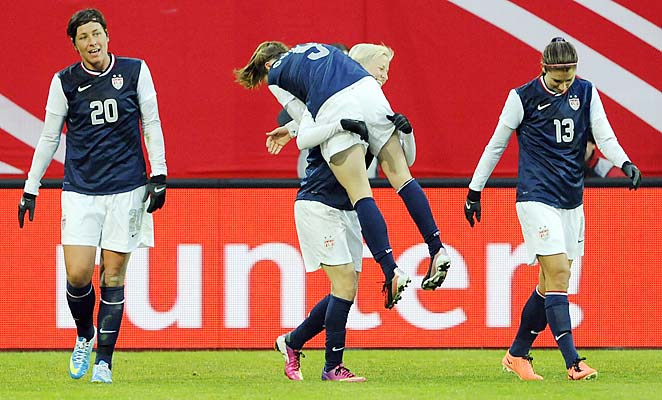 Alex Morgan, Heather O'Reilly, Megan Rapinoe and Alex Morgan celebrate a U.S. goal.
