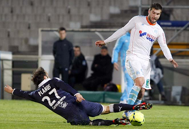 Marseille's Andre-Pierre Gignac (right) challenges with Bordeaux's Marc Planus.