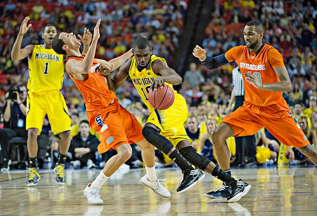 Syracuse wanted a foul called Michigan's Tim Hardaway Jr. on this play, instead the Orange's Michael Carter-Williams got whistled for his fourth foul and picked up his fifth not long afterwards.