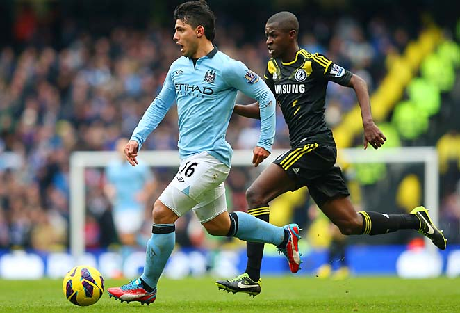 Sergio Aguero of Manchester City dribbles away from Chelsea's Ramires.