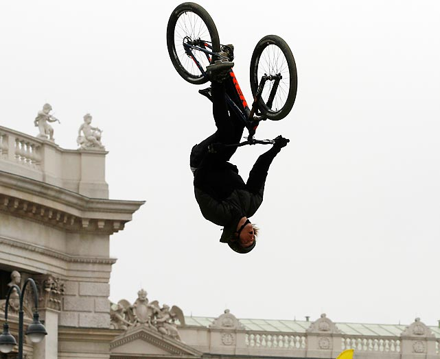 A participant does a full flip during the Vienna Air King bicycle festival in Austria.