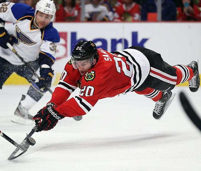 The Blackhawks' Brandon Saad dives for the puck during the 'Hawks 4-3 shootout loss against the Blues.