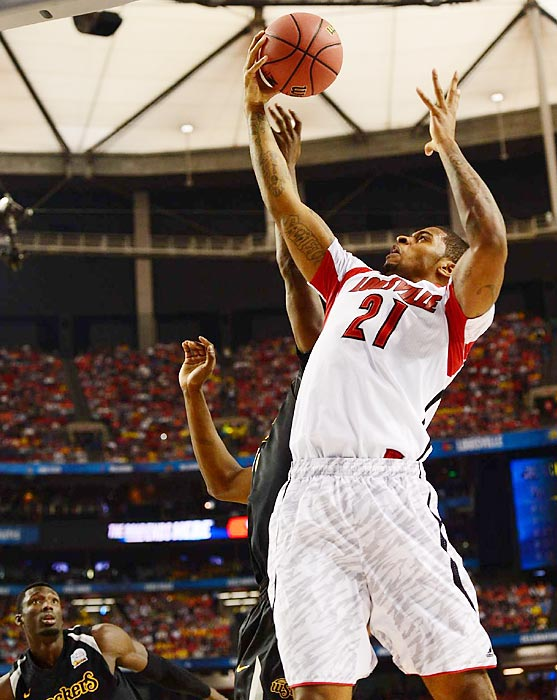Louisville's Chase Behanan rises up in front of a Wichita State defender during the Cardinals' Final Four game.