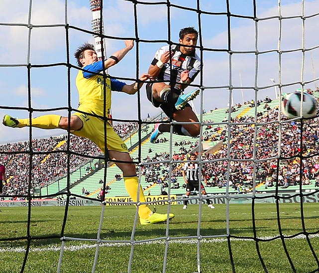 Udinese's Martin Benatia goes airborne as he scores during Udinese's 3-1 win over Chievo.