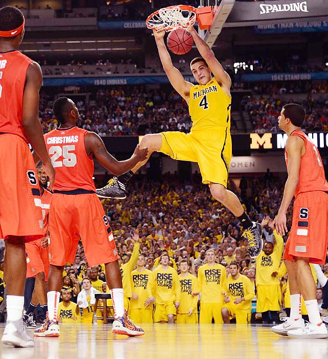 Michigan's burly freshman Mitch McGary throws down a slam dunk during the Wolverines' Final Four win over Syracuse.