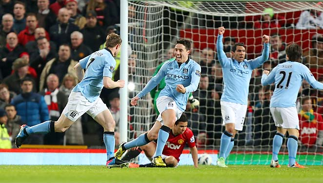 Manchester City celebrates James Milner's goal in the 51st-minute at Old Trafford.