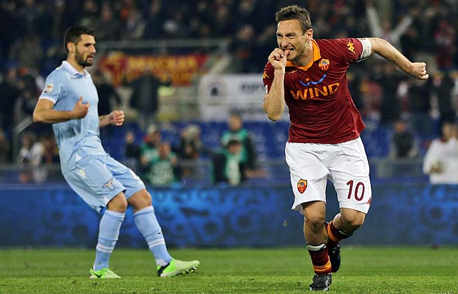 Francesco Totti celebrates after converting his penalty in the 56th minute.