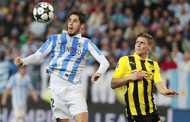Malaga's Isco (left) and Dortmund's Lukasz Piszczek challenge for the ball in the first leg.