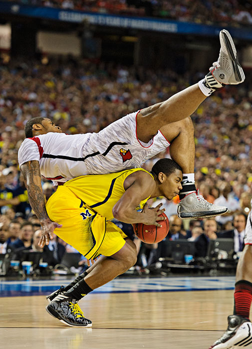 Louisville's Chane Behanan got fooled on this play and came down hard on Michigan's Glenn Robinson III.