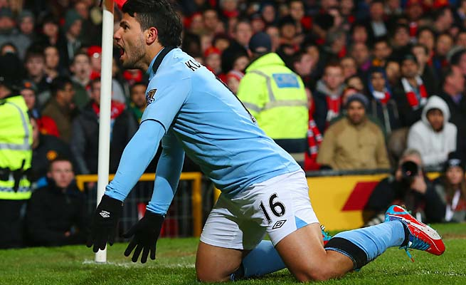 Sergio Aguero celebrates his deciding goal in Manchester City's 2-1 win at Old Trafford.