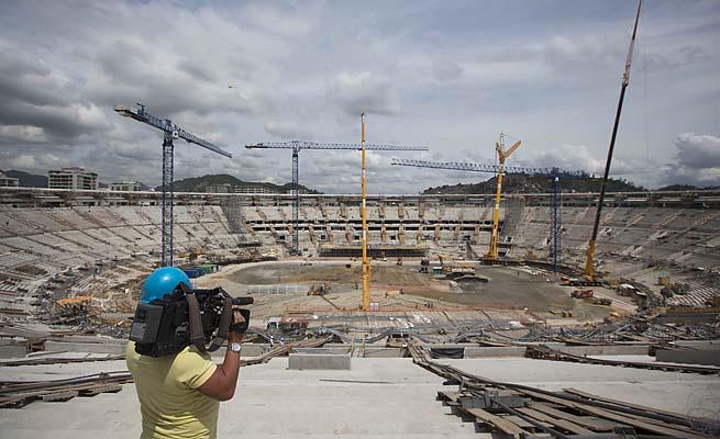 A cameraman films construction at the Maracana soccer stadium in November 2012.