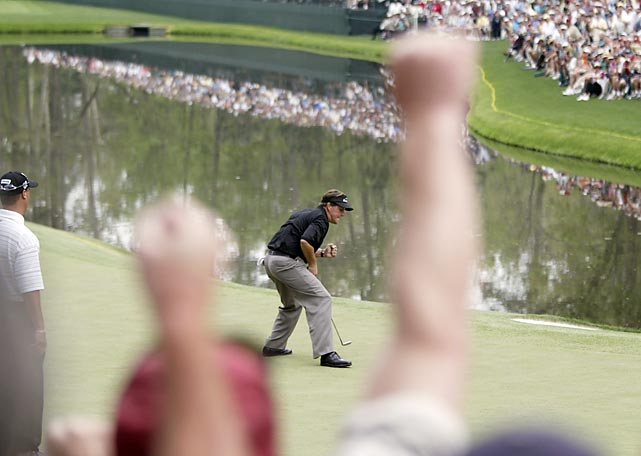Mickelson birdied five of the last seven holes, including the 16th (pictured), to beat Ernie Els by one stroke for his first green jacket.
