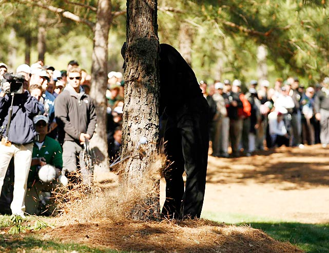 Woods broke his club hitting from behind a tree on the 11th hole Sunday at the 2007 Masters. Woods tied for second.