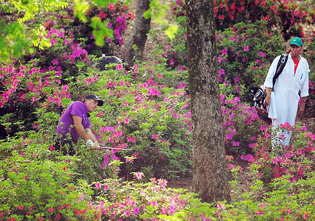 Phil Mickelson's purple shirt matched the azaleas on the 13th hole during the first round of the 2011 Masters.