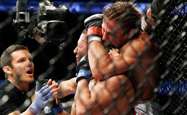 Urijah Faber (right) defeated Ivan Menjivar via submission during their UFC 157 bout in February.
