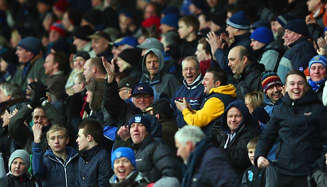 Portsmouth fans celebrate a goal during a League One match in March.