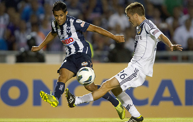 Monterrey's Severo Meza serves a ball past the L.A. Galaxy's Michael Stephens on Wednesday night.