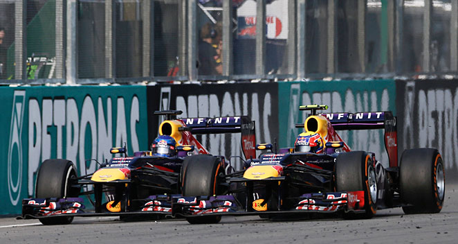 Sebastian Vettel (left) says Mark Webber (right) hasn't always acted in their team's best interests.