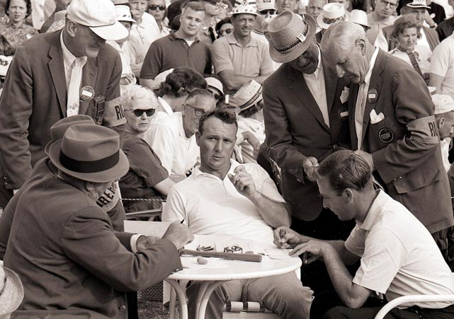 Arnold Palmer at the scorer's table after his win in 1964.