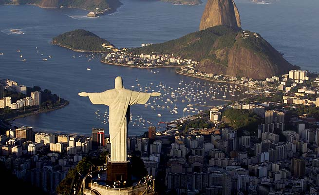 Christ the Redeemer overlooks Rio de Janeiro, site of the 2014 World Cup and the 2016 Olympics.