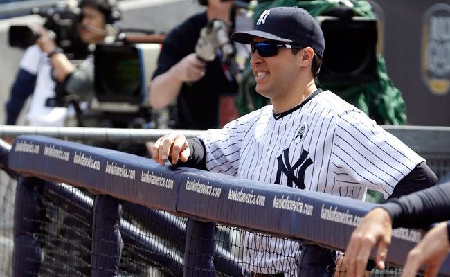 Mark Teixeira, who suffered a wrist injury in early March, watches Opening Day from the dugout.