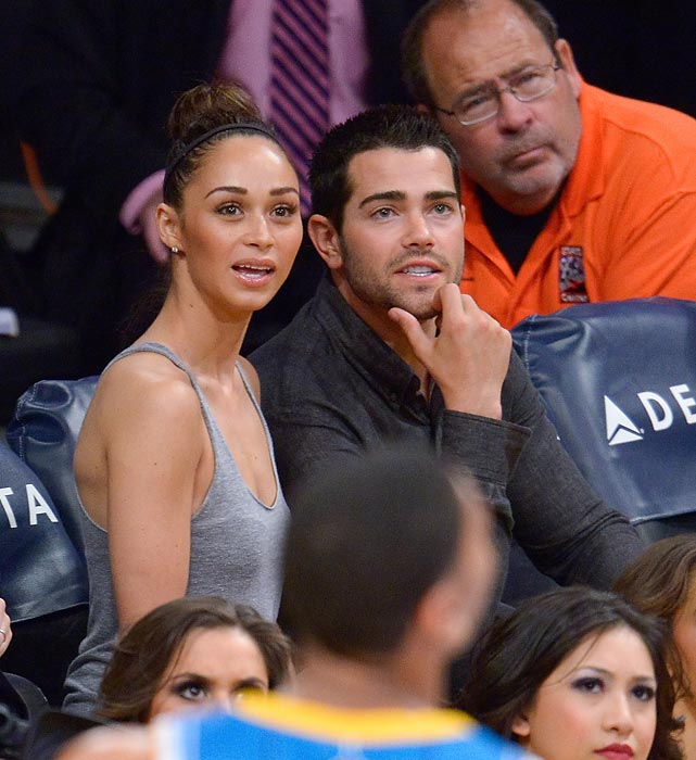 "Shock and <italics>awww</italics>: We'll let the UK's inimitable <italics>Daily Mail</italics> tell the tale: ""In between fast breaks and jump shots, Jesse Metcalfe and Cara Santana couldn't help but share a few loving kisses. The engaged couple sat courtside as the LA Lakers defeated the New Orleans Hornets. But while most pairs wait for the Kiss Cam to land on them before sharing a smooch, Jesse and Cara were happy to show their love throughout the basketball game."""