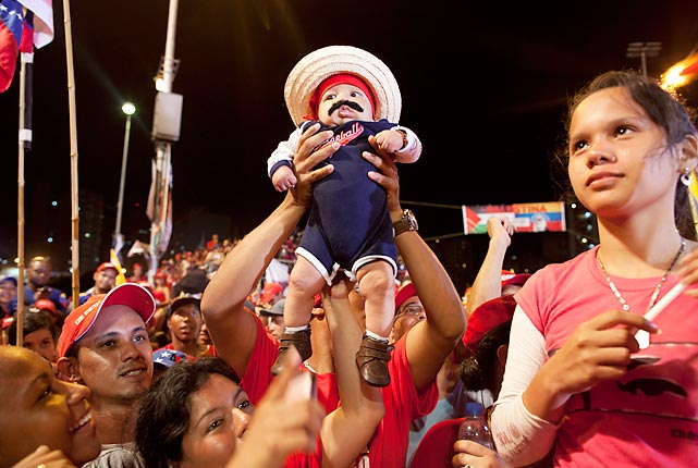 Supporters in Caracas hoist a life-sized replica of their favorite presidential candidate. Nicolas Maduro, the hand-picked successor of Venezuela's late Hugo Chavez, is running against opposition candidate Henrique Capriles, who has to work harder to attract the all-important mustache vote.