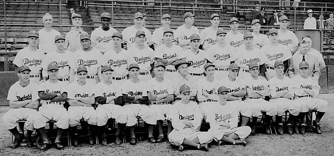 Norman Berman had a front-row seat in the team photo (legs crossed on right) and as a witness to history with the Jackie Robinson-led Dodgers.
