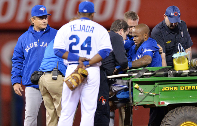Jose Reyes twisted his left ankle with an awkward slide in Toronto's win over Kansas City on Friday.