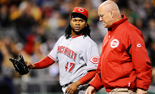 Cincinnati's Johnny Cueto left with pain in his right triceps after 4 1/3 innings on Saturday night.