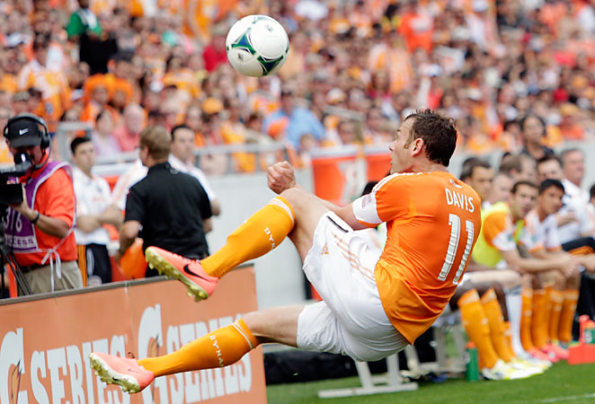 Brad Davis scored one goal and assisted the other as the Dynamo beat the Fire 2-1 Saturday.