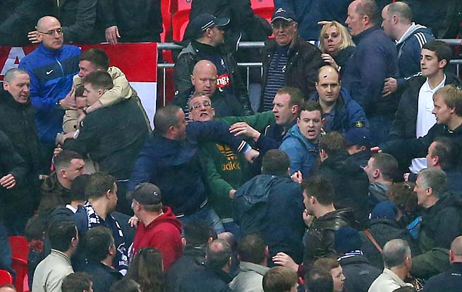 Trouble breaks out between Millwall supporters during the FA Cup semifinal with Wigan.