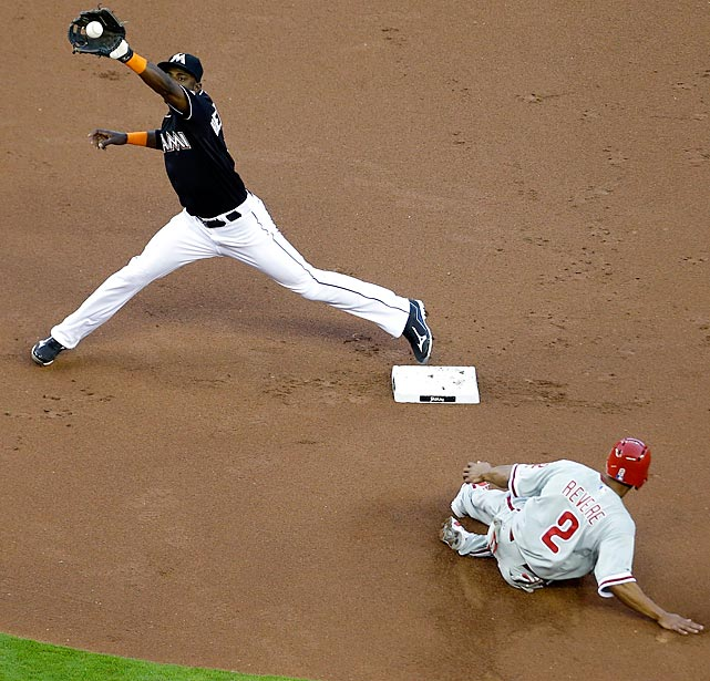 Miami Marlins' Adeiny Hechavarria reaches for the ball as Philadelphia Phillies runner Ben Revere (2) slides safely during the Phils' 3-1 Friday loss.