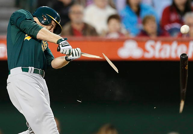 Oakland Athletics' Brandon Moss hits a broken-bat single against the Los Angeles Angels during the second inning of the A's 8-1 win in Anaheim.