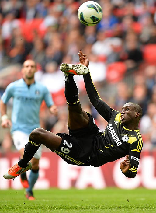 Demba Ba of Chelsea scores his team's first goal on a crafty side volley during the FA Cup with Budweiser Semi Final match between Chelsea and Manchester City at Wembley Stadium. Manchester City prevailed 2-1.