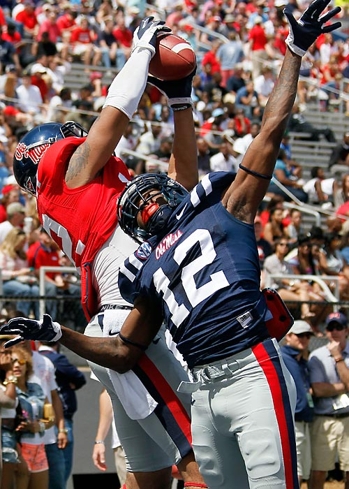 Mississippi wide receiver Donte Moncrief pulls down a pass in the end zone in front of defensive back Cliff Coleman (12) during drills before their spring NCAA college football scrimmage.