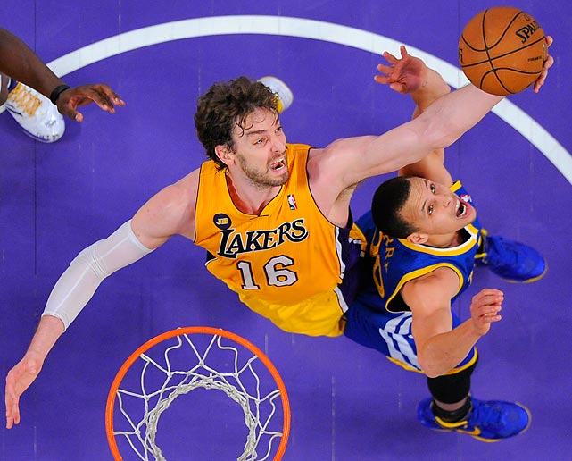 Lakers forward Pau Gasol and Warriors guard Stephen Curry reach for a rebound during the second half of the Lakers' critical 118-116 win. The Lakers improved their playoff chances despite losing Kobe Bryant to a season-ending injury.