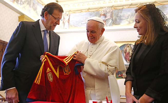 Pope Francis receives a jersey of the Spanish national soccer team as a gift from Spain's Prime Minister Mariano Rajo.