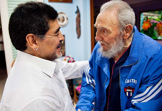 Diego Maradona greets Fidel Castro, who is wearing a Cuban Olympic jacket.