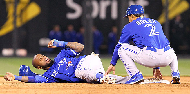 Jose Reyes hurt his ankle sliding into second base in Kansas City on Friday.