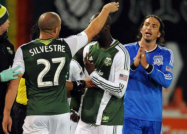 San Jose's Alan Gordon (right) directed a slur towards Portland's Will Johnson during Sunday's match.