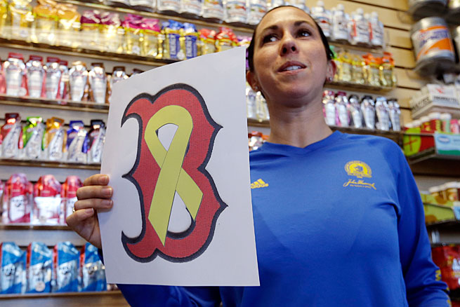 A Red Sox logo intertwined with a yellow ribbon honoring the victims of the attack is already becoming a symbol around Boston.