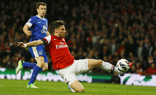 Olivier Giroud attempts a shot on goal for Arsenal, which is in third place in the Premier League.