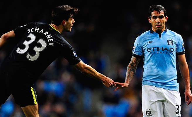 Carlos Tevez (right) scored in the 83rd minute to lift Manchester City over Wigan.