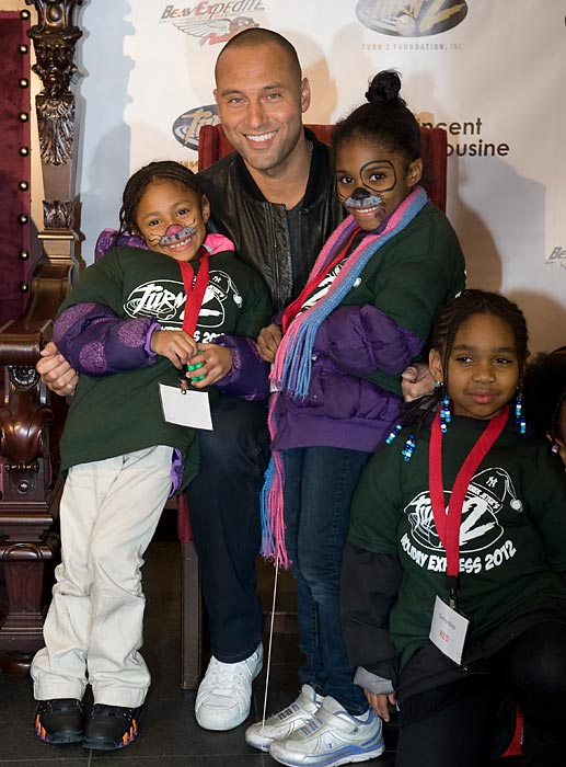 Derek Jeter hosted more than 500 children at Yankee Stadium, handing out gifts to boys and girls as part of his foundation's Turn 2 Holiday Express.