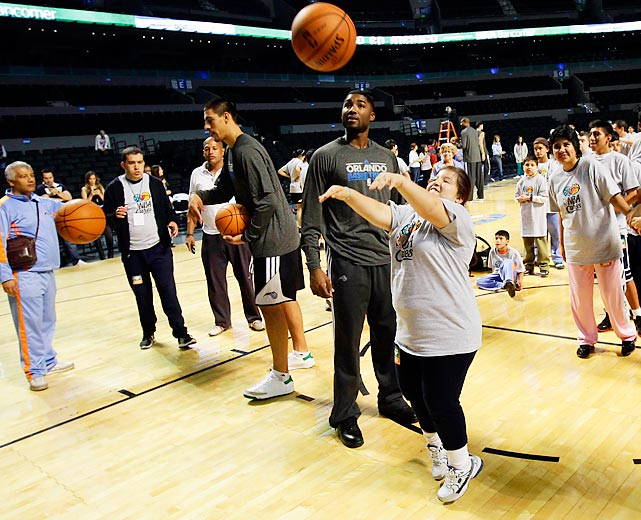 Then-Magic center Gustavo Ayon helps run a basketball clinic for disabled children with teammates during an NBA Cares outreach event in Mexico City.