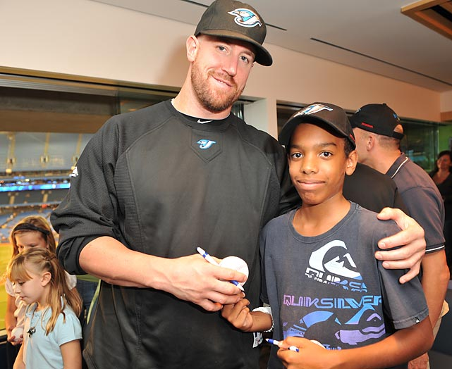 Then-Toronto catcher John Buck visits with kids from the Jays Care Rookie League and the Hospital for Sick Children during the unveiling of the Jays Care Community Clubhouse.