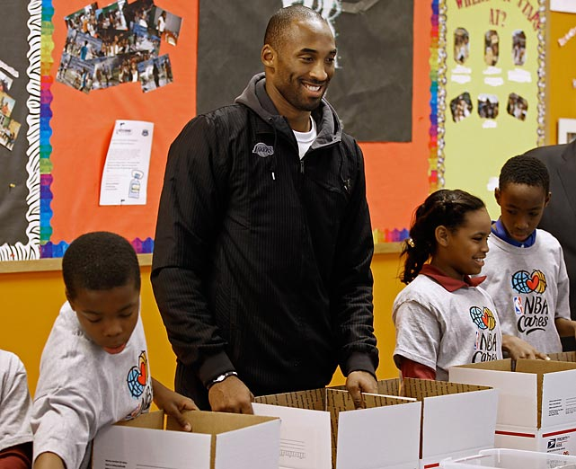 Lakers guard Kobe Bryant helps child volunteers prepare care packages during an NBA Cares service event at the Boys and Girls Club in Washington, D.C.
