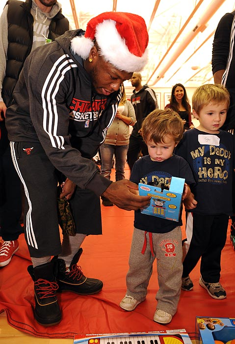 Bulls guard Nate Robinson bought toys for needy children and children of deployed military families for the team's USO/Chicago Housing Authority Holiday Party.