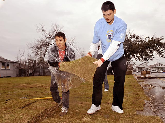 "Houston Rockets center Yao Ming and actor Jet Li do some landscaping at the ""Hands on New Orleans"" event at the Capdau School during the NBA's 2008 Day of Service."